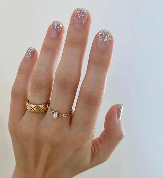 Rhinestones on a transparent background of nails