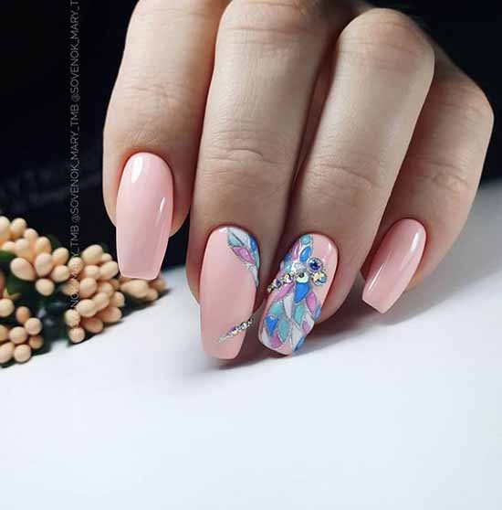 Pink with a pattern and rhinestones manicure