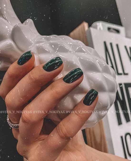 Dark green manicure