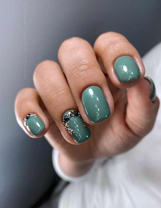 Green nail design with rhinestones