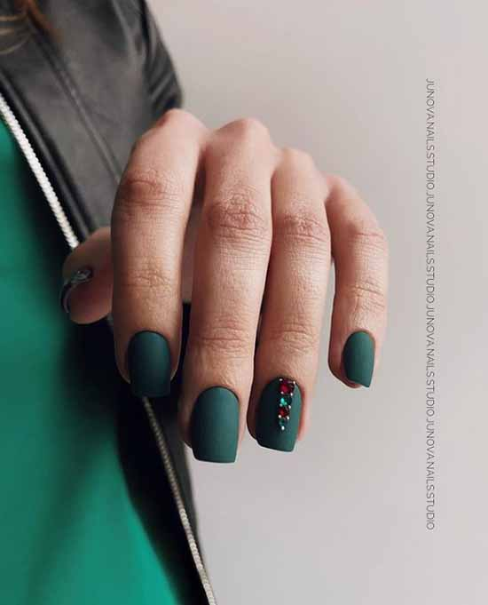 Green manicure with rhinestones to match