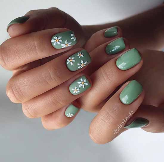 Green manicure with daisies