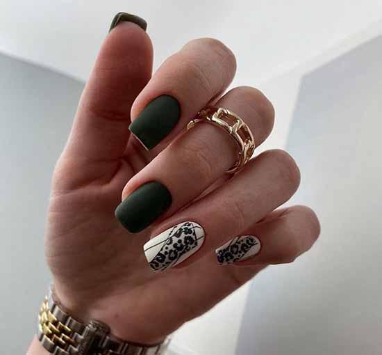 Dark green manicure design