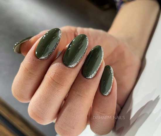 Green manicure with shiny decor