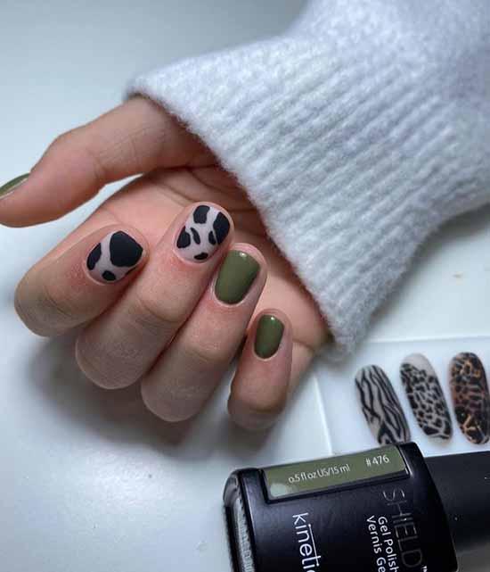 Khaki manicure with a predatory print