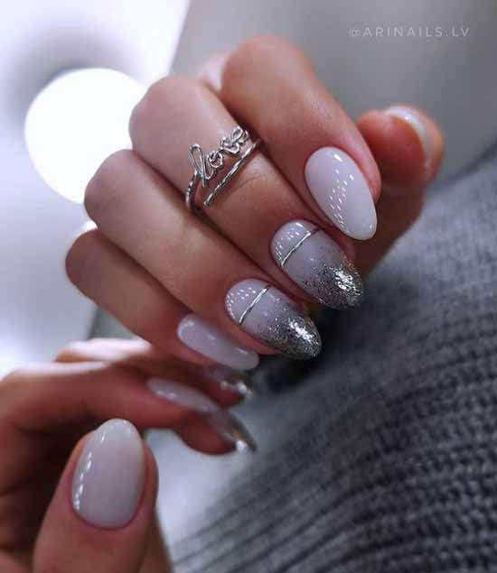 Silver sequins on the tips of the nails