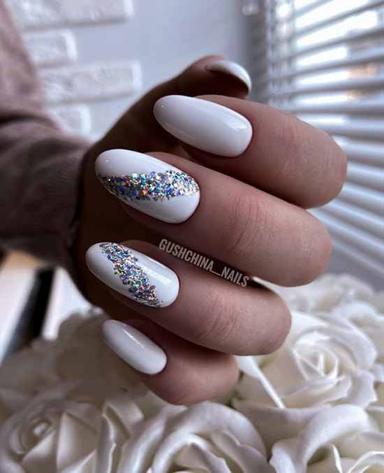 White nails with multi-colored glitters