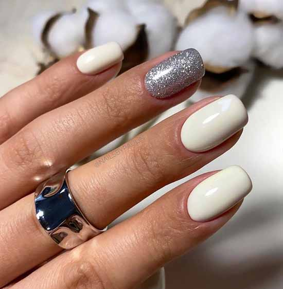 White nails and two glitter nails