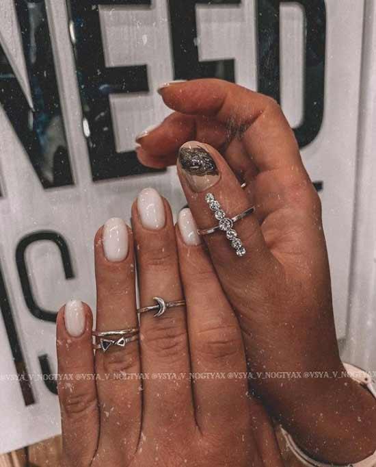 Delicate milky glitter manicure