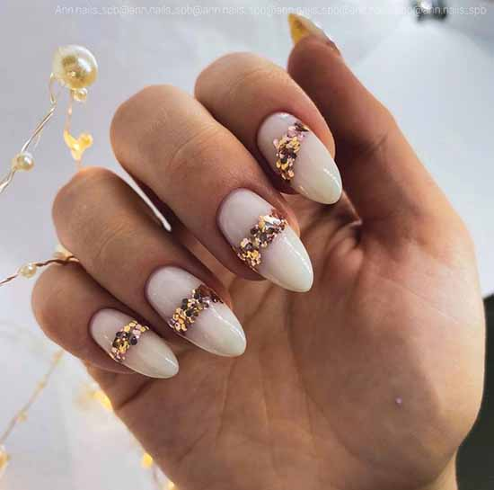 Long nails with gold sequins