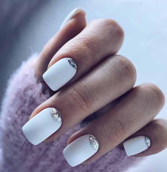 Snow-white manicure with glitters on each nail