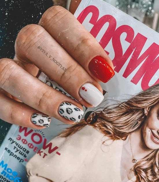 White nails with glitter and predatory print