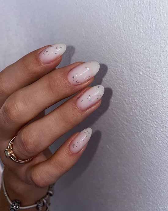 Delicate milky silver glitter manicure