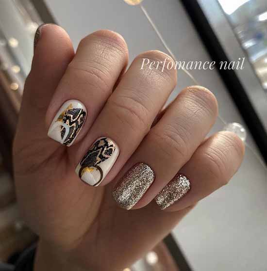 White manicure with sparkles in gold