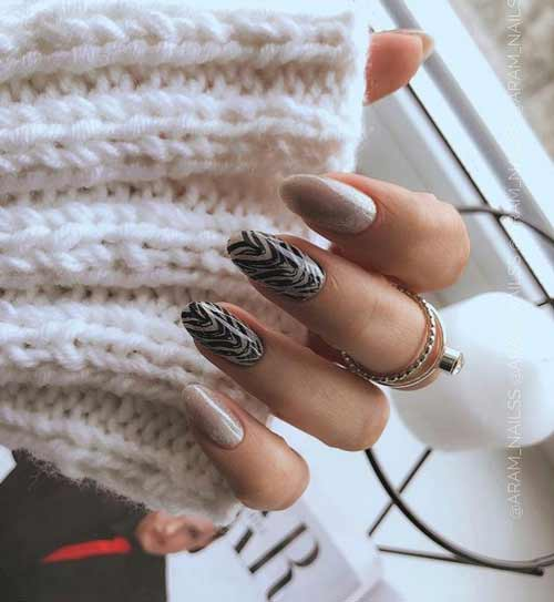 Fashionable predatory prints in manicure