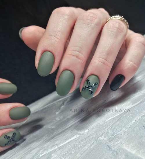 Matte green manicure and black rhinestones