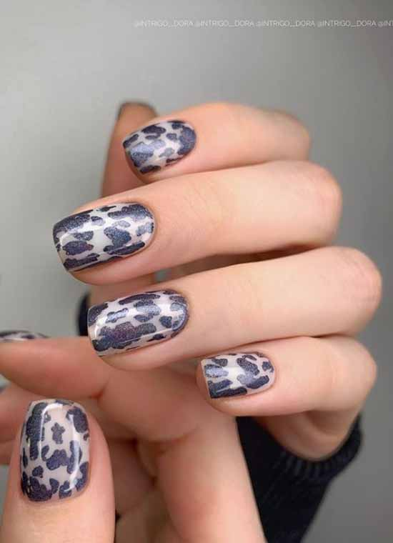 Fashionable manicure with black spots