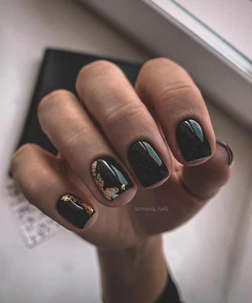 Black manicure with foil