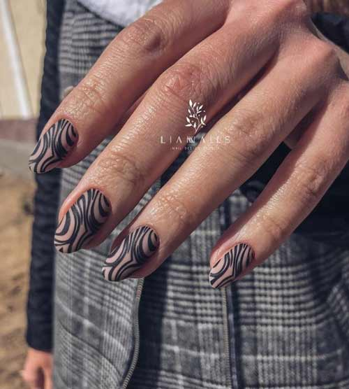 Black animal print on nails