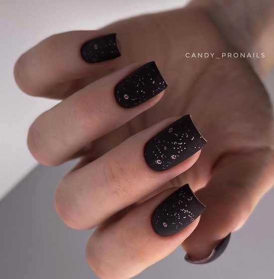 Matte black glitter manicure