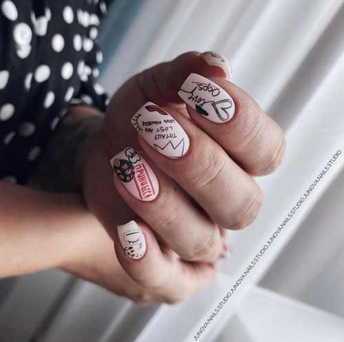 Matte nail design with a heart