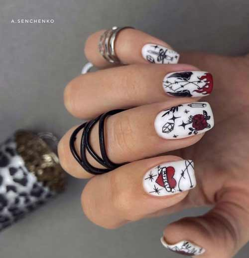 Daring manicure with a red heart