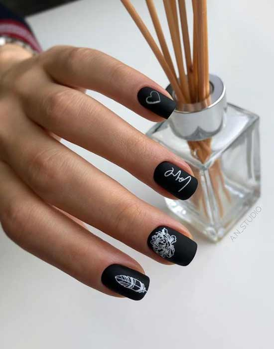 Black manicure with a heart