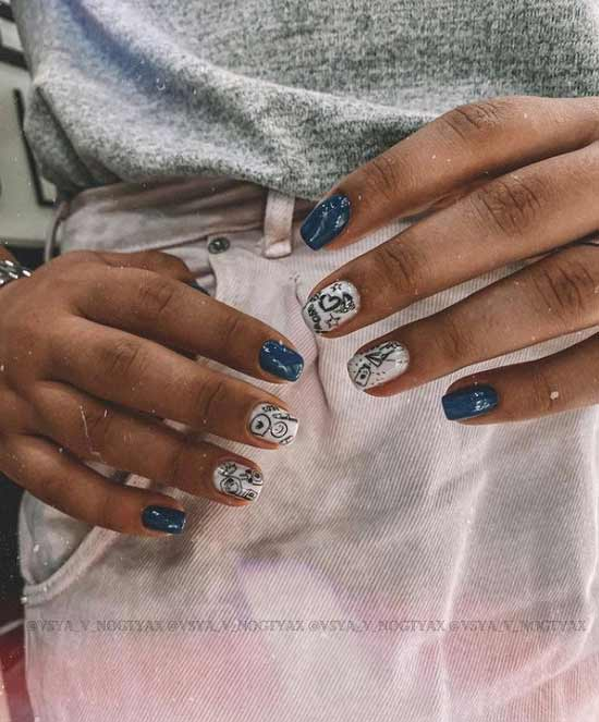 Blue manicure with a heart