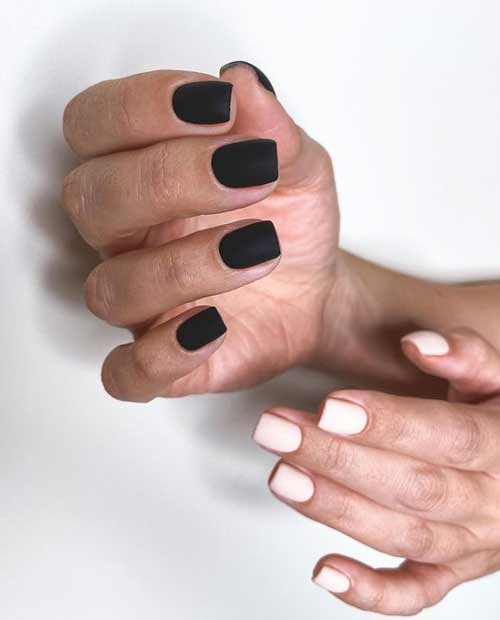Black manicure on one hand, white on the other