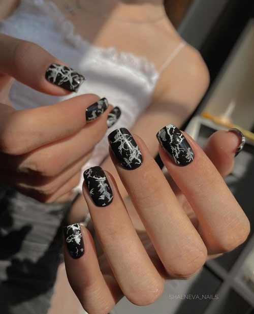 Black marble on nails