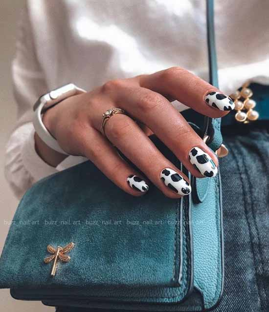 Black and white cow print on nails
