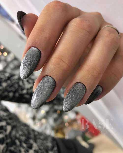 Silver cat on black gel polish