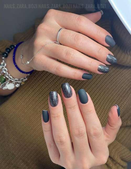 Matte black manicure and silver cat's eye