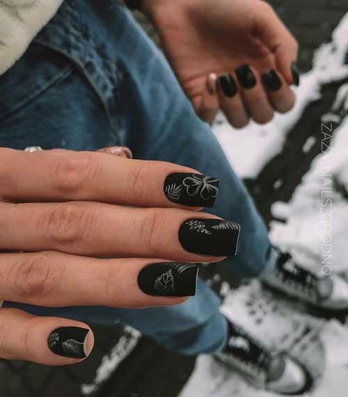 Black manicure in the photo