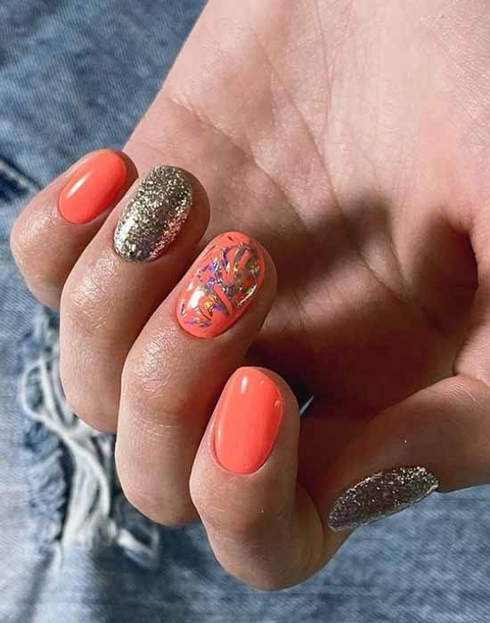 Trendy orange manicure spring
