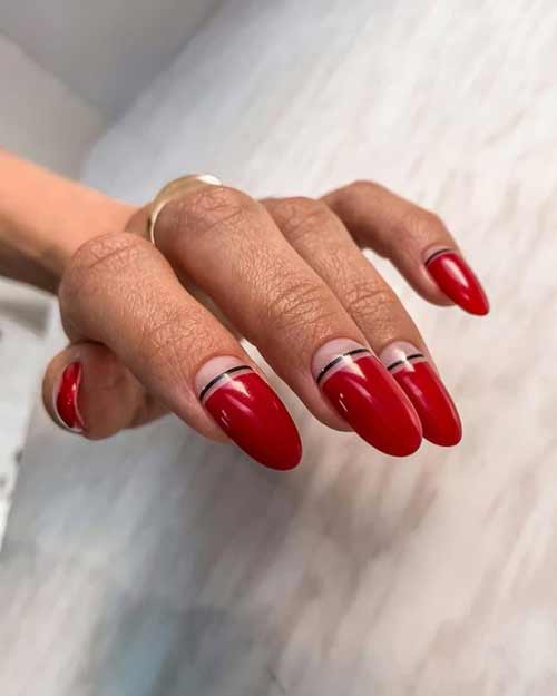 Red manicure with transparent holes
