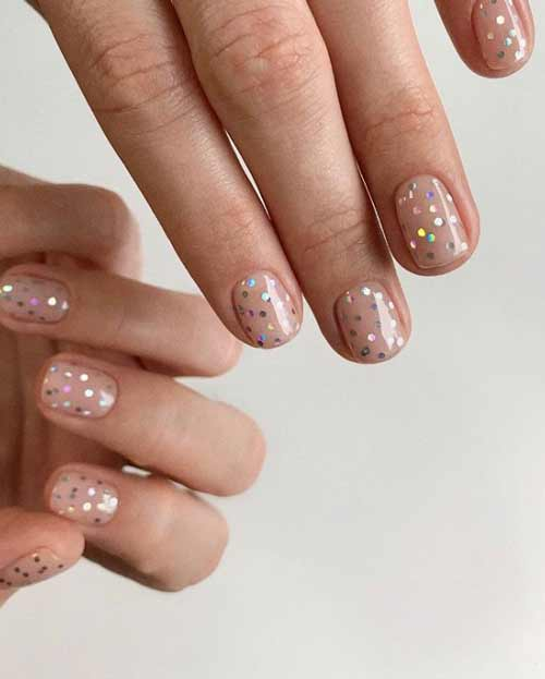 Glitter manicure on transparent space