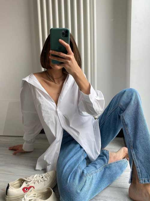 Wide leg jeans with slits and white shirt