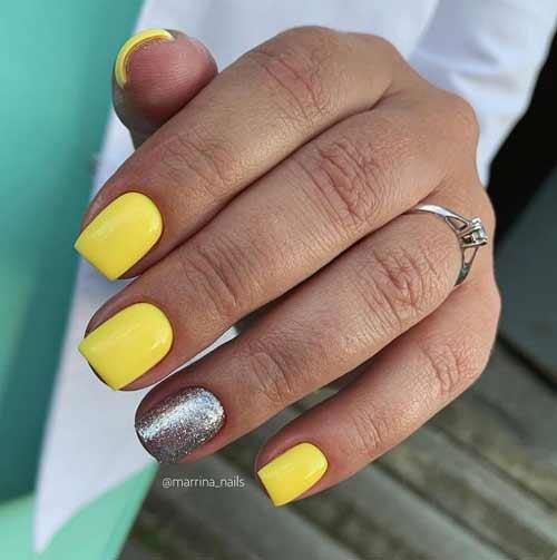 Bright yellow glitter manicure