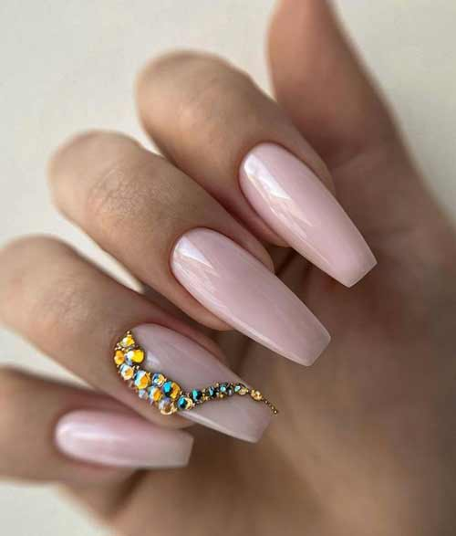 Nude manicure with rhinestones