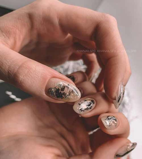 Chic manicure with gold leaf