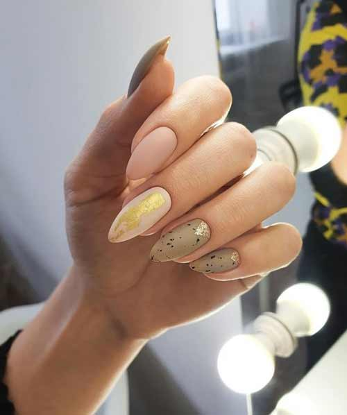 Beige manicure with foil