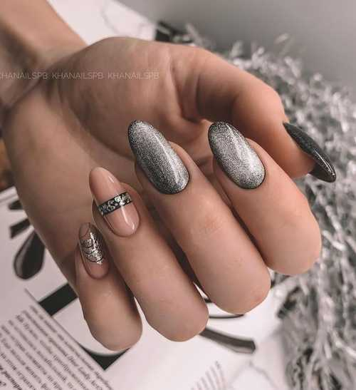 Cat's eye manicure in gray tones