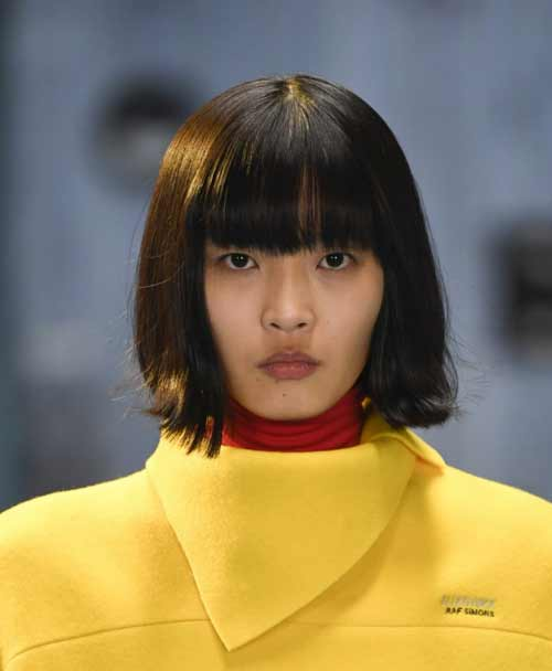 Fashionable bangs in Prada style