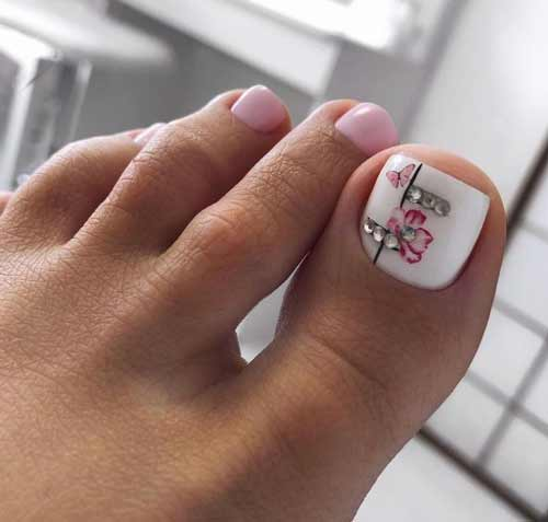 White pedicure with a flower