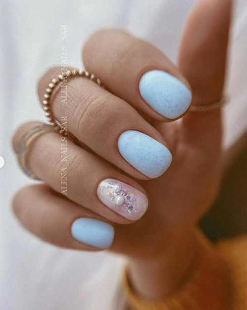 Blue manicure with designs