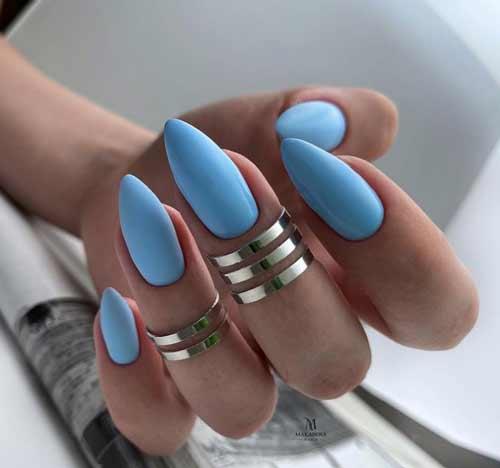 Blue manicure sharp nails