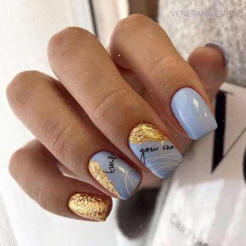 Blue nail color and gold leaf