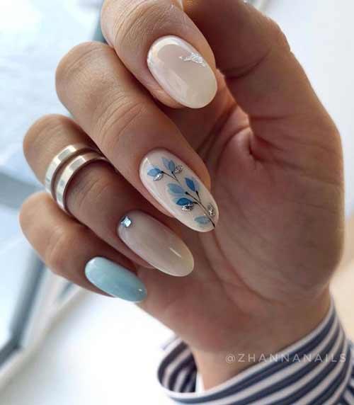 Delicate spring manicure in blue tones