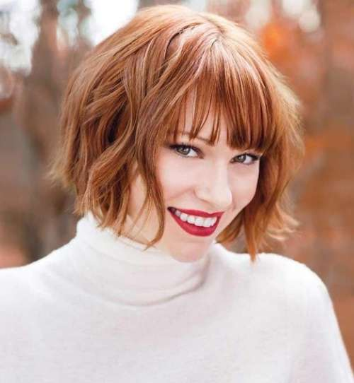 Red bob with torn bangs